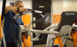 Sanitizing workout equipment handle with steam