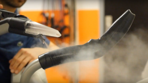 Using steam to clean machine handlebar