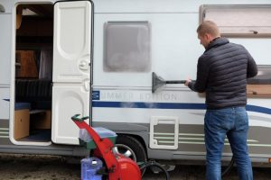 Removing tree sap from a camper with steam cleaning
